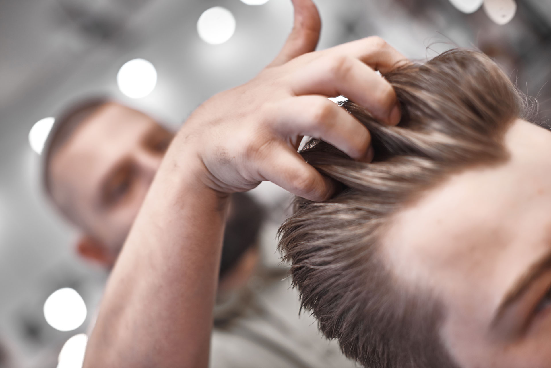 Man gets a haircut at the barber shop in Playa Vista, CA